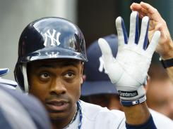 Yankees center fielder Curtis Granderson hit a three-run home run during the third inning as New York upended Detroit 12-8.