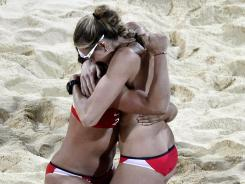 United Kingdom; Misty May-Treanor and Kerri Walsh (left) celebrate winning the gold medal after defeating April Ross and Jennifer Kessy (USA) in the women's beach volleyball gold medal match during the 2012 London Olympic Games at Horse Guards Parade.