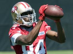 ORG XMIT: USPW-94774 July 27, 2012; Santa Clara, CA, USA; San Francisco 49ers wide receiver Randy Moss (84) catches a pass during training camp at the 49ers practice facility. Mandatory Credit: Ed Szczepanski-US PRESSWIRE ORIG FILE ID: 20120727_ajl_bs4_073.jpg