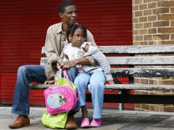 Claudius John, shown with his daughter Reana, 7, has been a Stratford resident for 30 years.