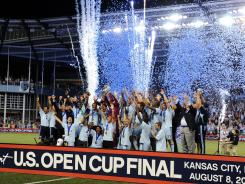 Sporting KC celebrates after winning the U.S. Open Cup Final against Seattle Sounders on Wednesday night.