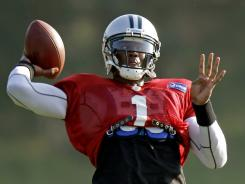 Panthers quarterback Cam Newton is far from satisfied, even after winning AP Rookie of the Year honors last season.