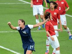 Abby Wambach celebrates after a goal by midfielder Carli Lloyd gave the U.S. a 1-0 lead in the gold medal match.