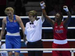 Teenage dream: The USA's Claressa Shields, right, celebrates winning the gold medal in middleweight boxing after the 17-year-old's win Thursday against Russia's Nadezda Torlopova.
