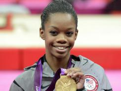 Gabby Douglas poses with her gold medal after winning the women's individual all-around final during the 2012 London Olympic Games.