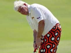 John Daly watches his putt on the 13th hole as he surprisingly is up with the leaders in the first round of the PGA Championship on the Ocean Course at Kiawah Island, S.C.