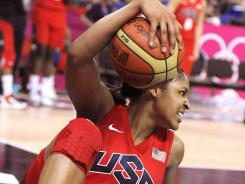 Maya Moore helped the U.S. women's basketball team rally past Australia and into Saturday's gold medal game.