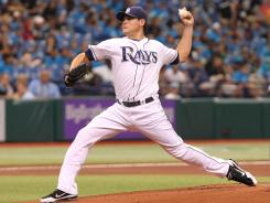 Rays starting pitcher Matt Moore (55) throws a pitch in the first inning against the Toronto Blue Jays on Thursday.