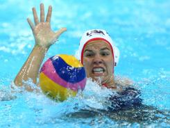 Team USA's Kami Craig gathers the ball in the water polo gold-medal match against Spain, which the U.S. won for their first gold medal in the event.