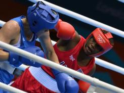 Claressa Shields of the USA, right, battles Nadezda Torlopova of Russia in the middleweight final.