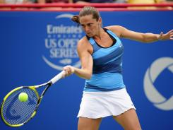 Italy's Roberta Vinci pounded 2006 champion Ana Ivanovic of Serbia in just 45 minutes.
