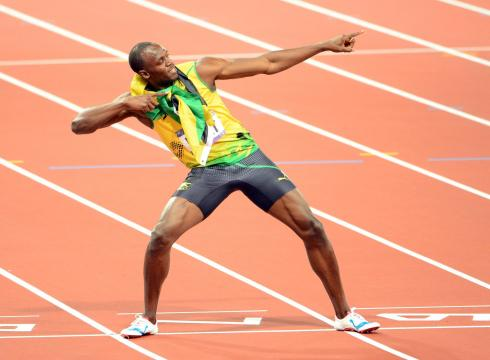 Photos on Usain Bolt Shows Off The Famous Pose After Winning The 200 Thursday At