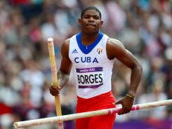 Cuba's Lazaro Borges competes in the men's pole vault qualifications at the athletics event of the London 2012 Olympic Games.