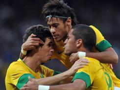 20-year-old striker Neymar, center, leads the Brazilian attack as the country will play for the elusive gold medal vs. Mexico on Saturday.