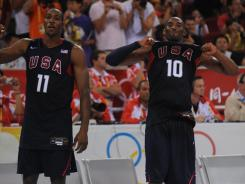 Dwight Howard, left, and Kobe Bryant, who were teammates on the USA's gold-medal winning 2008 Olympic team, will get a chance to put it all together as teammates for the Los Angeles Lakers after Thursday's four-team NBA trade.