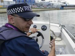 London, USA; Constable Joss Hawthorn on security patrol in the Lee Navigation Canal adjacent to the Olympic Park during the London 2012 Olympic Games.