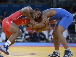 Earlier in the day before his gold-medal match Jordan Burroughs (left) and Francisco Daniel Soler Tanco compete in the London Games.