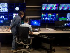 Pac-12 Networks engineers prep the new studio for Wednesday's launch.