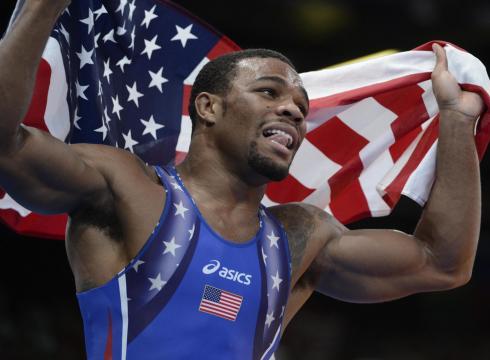 The USA's Jordan Burroughs celebrates Friday after winning the gold
