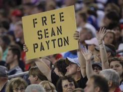 A New Orleans Saints fan expresses his sentiments during their first NFL preseason football game against the New England Patriots in Foxborough, Mass. on Thursday, Aug. 9, 2012.