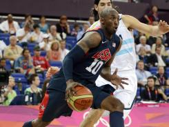 Kobe Bryant drives to the hoop in the first half of the USA's semifinal game against Argentina.