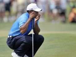 Tiger Woods had his putting right on target Friday to tie for the lead after two rounds of the PGA Championship at the Ocean Course at Kiawah Island, S.C.
