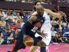 Kobe Bryant, driving past Argentina's Luis Scola, scored 11 of his 13 points in the first quarter Friday and ignited the U.S. men's team to a rout and a spot in the gold medal game Sunday in the London Olympics.