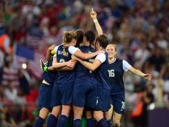 U.S. players celebrate after defeating Japan 2-1 during the women's soccer gold medal match in the 2012 London Olympics at Wembley Stadium on Thursday.