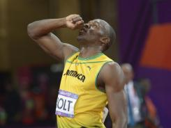 Usain Bolt celebrates after winning the gold in the men's 200-meter final during the London 2012 Olympic Games at Olympic Stadium.