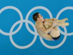 David Boudia dives in the men's 10-meter platform semifinals during the London Olympics at Aquatics Centre on Saturday.