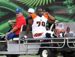 Bengals tackle Travelle Wharton is carted off the field with a knee injury against the New York Jets.