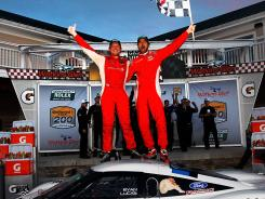 Ryan Dalziel and Lucas Luhr of the No. 8 Starworks Motorsport Ford/Riley celebrate after winning Saturday at Watkins Glen.