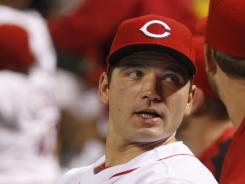 The Reds' Joey Votto was batting .342 with 14 homers and 49 RBI before his surgery.