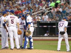 The Mets' Johan Santana, right, was charged with eight hits and a season-high eight runs in his first outing since July 20.