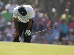 Tiger Woods reacts to his errant drive on the third hole during the third round Saturday of the PGA Championship at Kiawah Island, S.C. Unfortunately for Woods, that wasn't the least of his problems, as he was 3-over through seven holes and trailing Vijay Singh and Rory McIlroy by five shots when play was called.