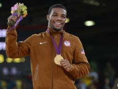 Wrestler Jordan Burroughs, celebrating after winning gold, wants the USA to beat China in the medal race.