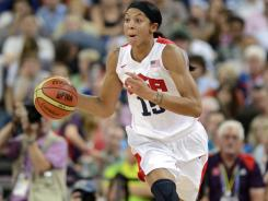 Forward Candace Parker brings the ball up court against France as the U.S. women rolled to their fifth consecutive gold medal.