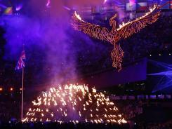 The Olympic flame is lowered during the closing ceremony for the London Games.