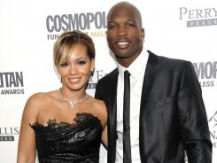 Chad Johnson, right, poses with his then-fiancee, Evelyn Lozada, at an event in New York on March 7. Johnson was arrested Saturday, Aug. 11, 2012, on a domestic violence charge, accused of head-butting Lozada during an argument in front of their home outside Miami.