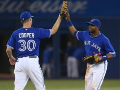 Blue Jays outfielder Rajai Davis, right, matched a career high with five RBI.