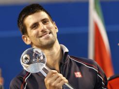 Novak Djokovic holds the Rogers Cup trophy after defeating Richard Gasquet 6-3 and 6-2 in the Rogers Cup final at the Rexall Centre.