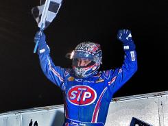 Donny Schatz waves the checkered flag after winning the final race at the Knoxville Nationals.