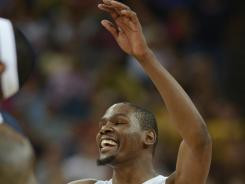Kevin Durant celebrates after winning the gold in the men's basketball final against Spain in the London 2012 Olympic Games. Durant set a U.S. Games scoring record.