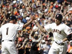 Hunter Pence rounds third after hitting a home run Sunday at AT&amp;T Park, where the Giants are averaging 41,734 fans a game this season.