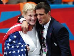 Kayla Harrison celebrating her judo gold medal with her coach, Jimmy Pedro, is just one of our many most memorable moments from the 2012 London Olympics.