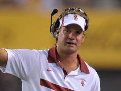 Southern California coach Lane Kiffin stepped down from voting in the coaches poll.
