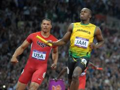 Usain Bolt reacts after defeating Ryan Bailey to set a world record of 36.84 during the London 2012 Olympic Games at Olympic Stadium.