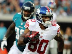 Giants wide receiver Victor Cruz (80) runs the ball up the field during the first quarter of the preseason game against the Jaguars.
