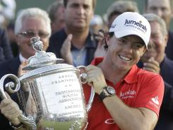 Rory McIlroy of Northern Ireland holds up the Wannamaker Trophy after his record eight-shot victory Sunday at the PGA Championship at Kiawah Island, S.C.