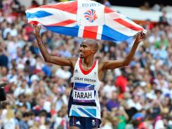Mohamed Farah celebrates after winning the men's 5,000-meter final during the 2012 London Olympic Games at Olympic Stadium.